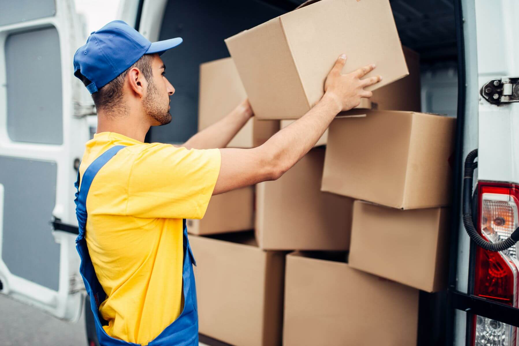 Cargo delivery service male courier unload truck by Shipper's Advocate Parcel & Freight Cost Reduction