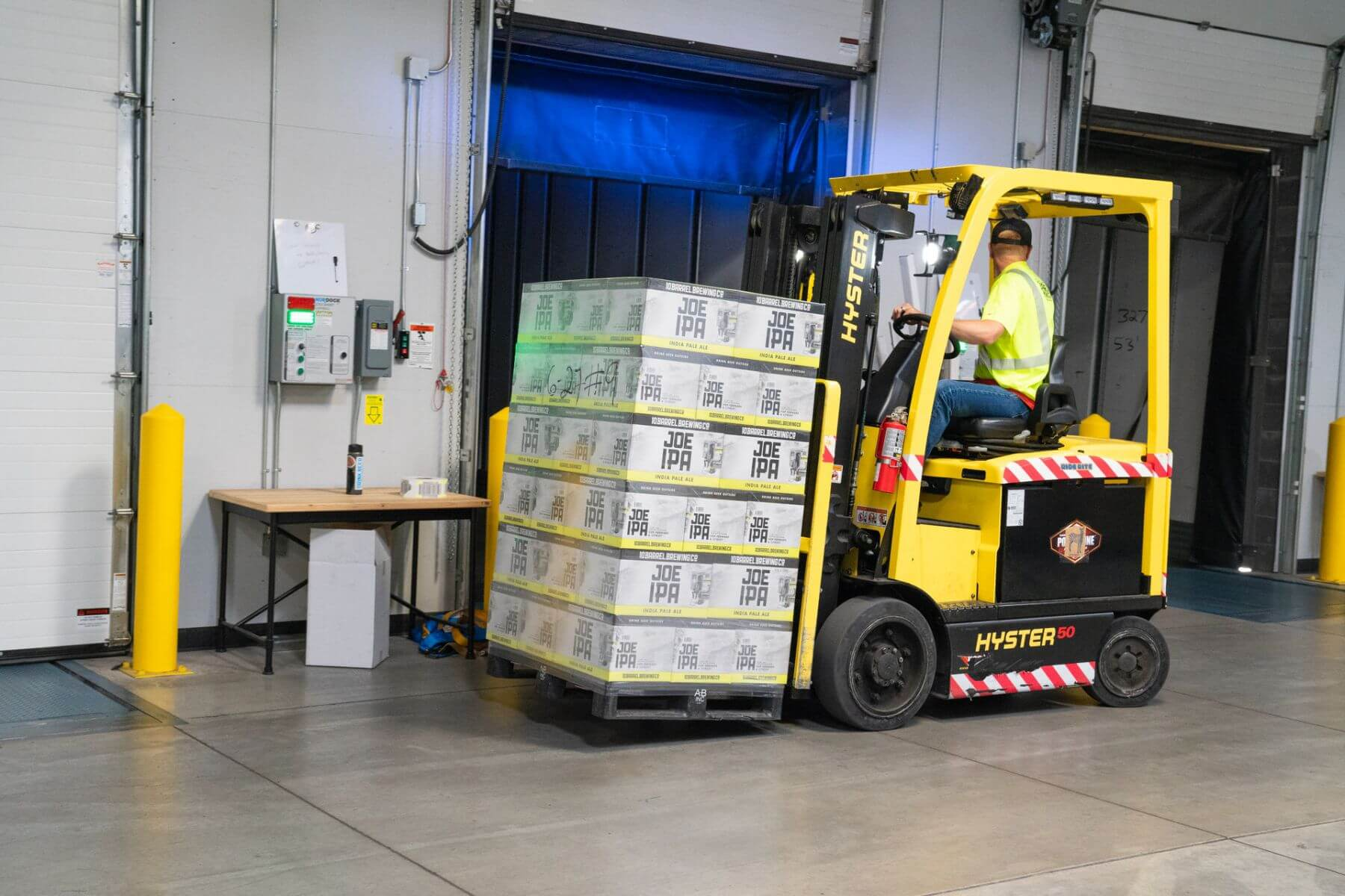 Man Riding on Yellow forklift by Shipper's Advocate Transportation Experts