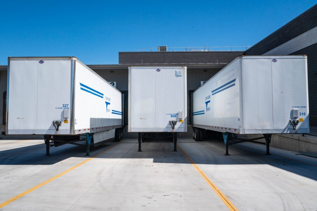 Three white Enclosed Trailers by Shipper's Advocate International transportation experts